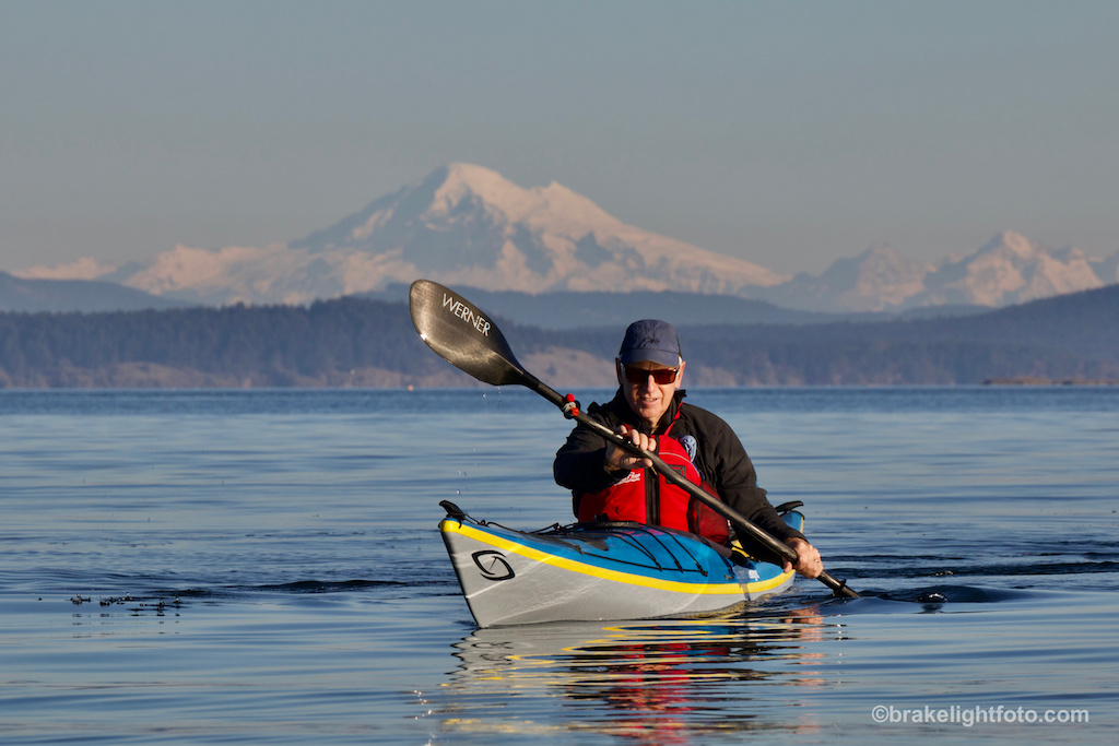 Brian Henry paddling in front of Mt Baker